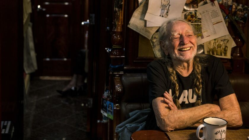 """Texas singer-songwriter Willie Nelson, on his tour bus in Hollywood before a taping of """"Jimmy Kimmel Live!,"""" has a released a new song titled """"Vote 'Em Out"""" ahead of the November midterm elections."""