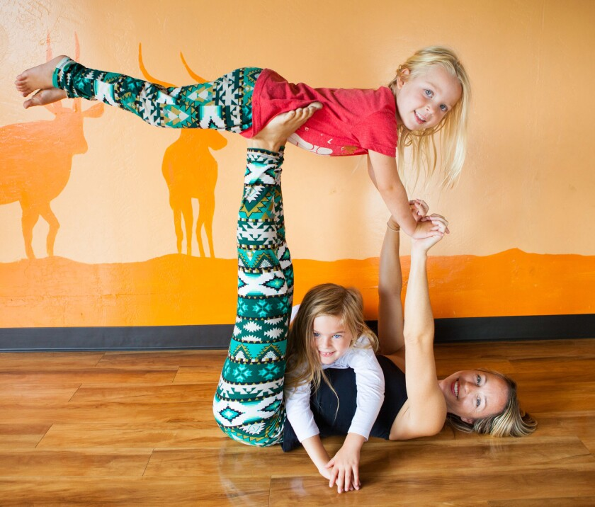 If I Was a Bird Yoga founder Tiffany Gullberg with little yogis, daughters Juliet and Pearl.