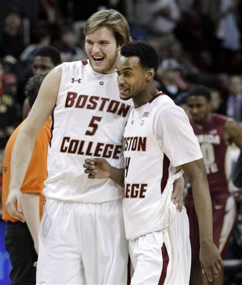Boston College's K.C. Caudill (5) and Matt Humphrey (14) celebrate their 64-60 victory over Florida State in an NCAA college basketball game in Boston on Wednesday, Feb. 8, 2012. (AP Photo/Elise Amendola)
