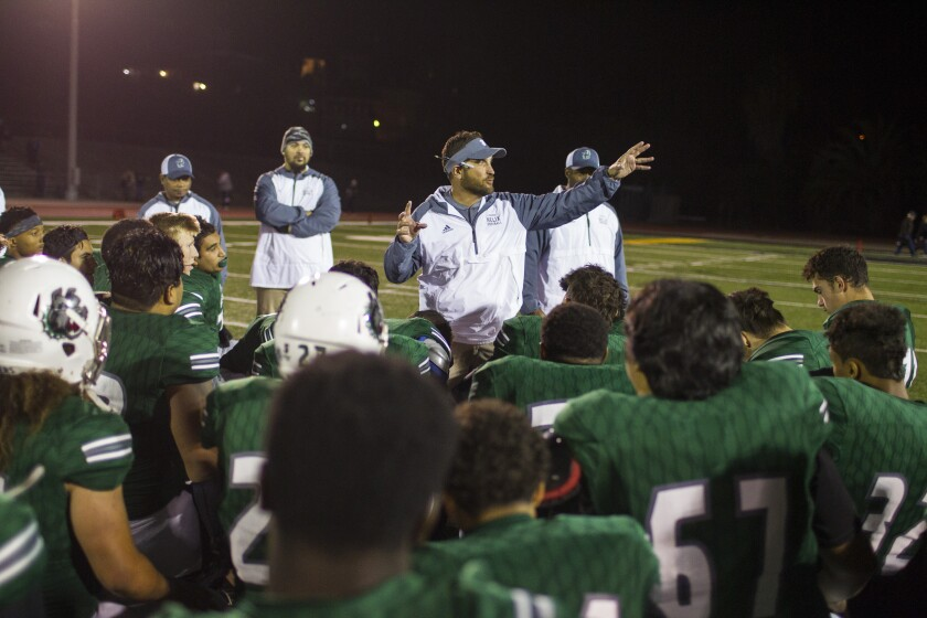 Helix head coach Robbie Owens speaks to his team after their victory over Rancho Bernardo.