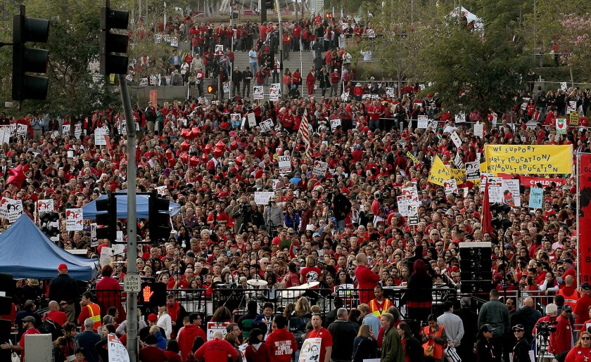 Thousands of teachers from throughout the Los Angeles Unified School District rally to press for contract demands in downtown's Grand Park.