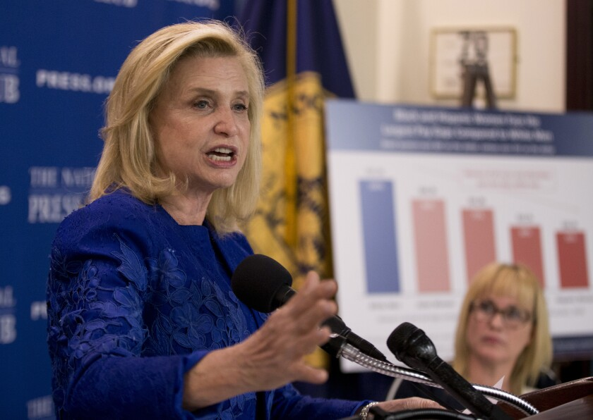 In this April 12, 2016 file photo, Rep. Carolyn Maloney, D-N.Y., speaks during a National Press Club Newsmaker news conference, on Equal Pay Day, at the National Press Club in Washington. Maloney suffered a medical episode while appearing at an event in New York City, Monday Oct. 7, 2019. Maloney and other politicians were attending a community vigil about the weekend killing of four homeless men in the borough's Chinatown section. She was taken to a hospital. (AP Photo/Manuel Balce Ceneta, File)