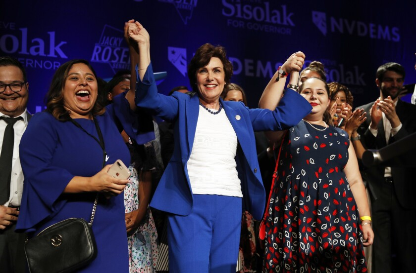 Rep. Jacky Rosen, D-Nev., center, celebrates at a Democratic election night party after wining a Senate seat Wednesday, Nov. 7, 2018, in Las Vegas.