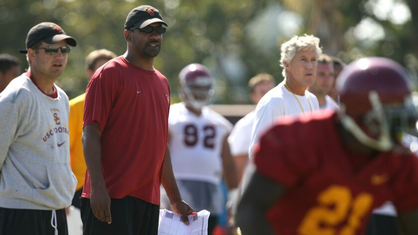 Former USC Trojans tailback coach Todd McNair watches USC team scrimmage with former head coach Pete Carroll.
