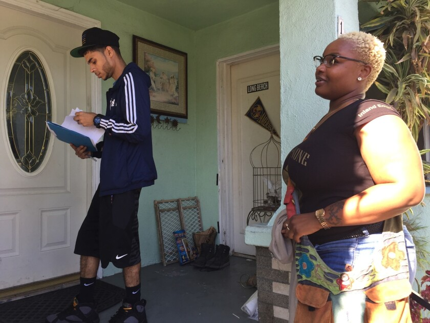 Wendell Sherman, left, of Long Beach Rising and Amber-Rose Howard of All of Us or None and A New Way of Life canvass Nov. 5 in Long Beach. Howard asked voters to support Proposition. 64, the pot legalization measure. Sherman focused on Propositions 55, 56 and 57.