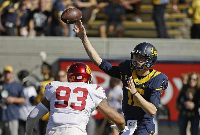 California quarterback Jared Goff, right, throws the ball under pressure from Southern California defensive end Greg Townsend Jr., left, during the first half of an NCAA college football game, Saturday, Oct. 31, 2015, in Berkeley, Calif. (AP Photo/Eric Risberg)
