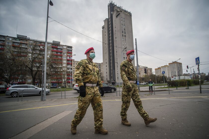 Two military police officers patrol the streets in Budapest, Hungary.