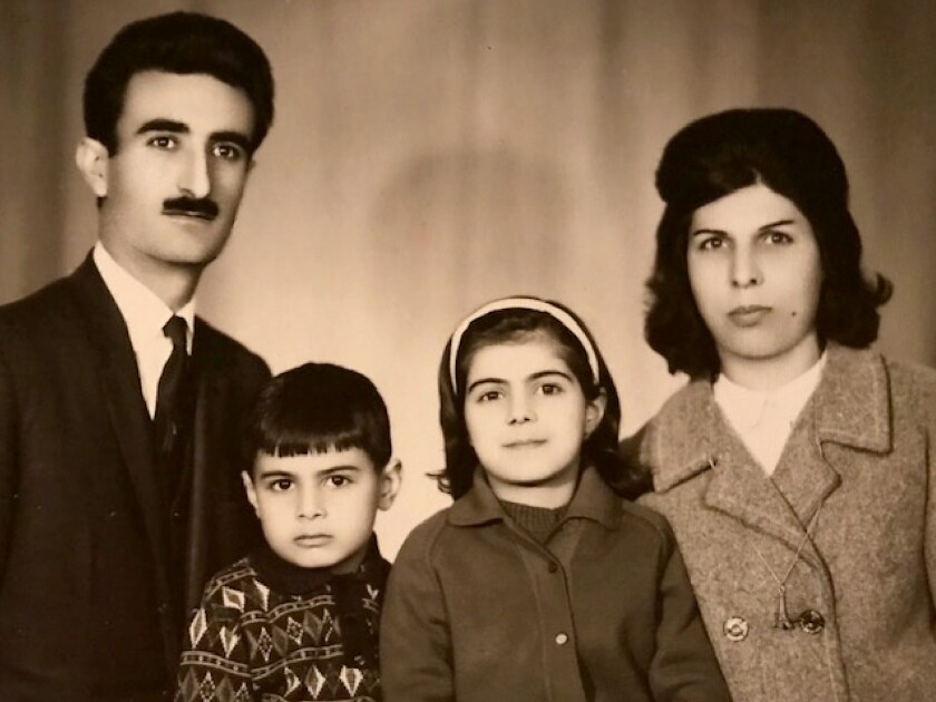 A family portrait of Hassan, Behrooz, Sholeh and Farideh Moghaddam, taken in Iran in 1967.