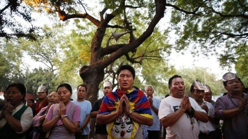 Tibetan exiles at a memorial in New Delhi on May 17, the day marked as International Tibet Solidarity Day. The vigil was held to pay homage to Tibetans who have self-immolated since 2009 for the cause of Tibet and its religious, cultural and political autonomy.