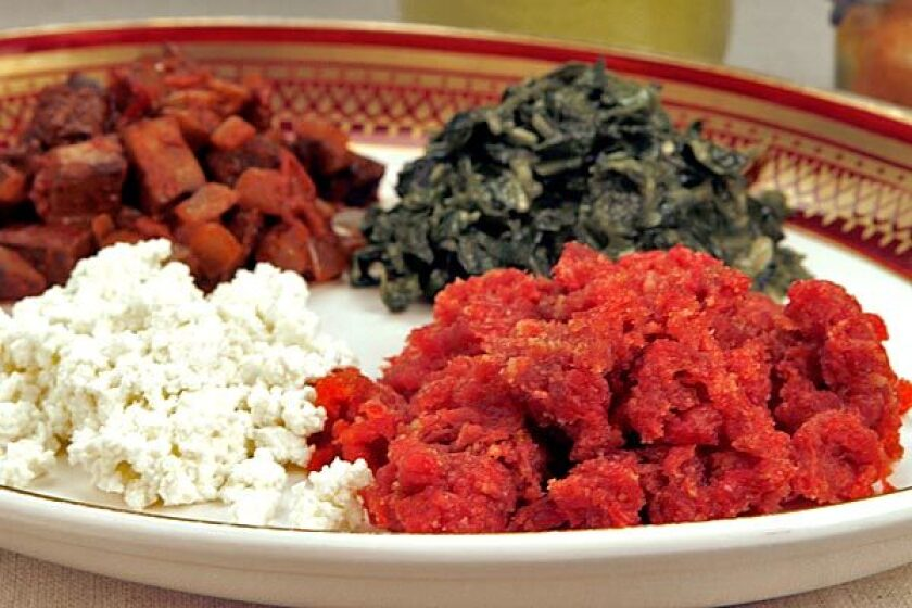 Spices, butter and ground beef make <i>kitfo</i>. It's served with cheese, mushrooms and collard greens.