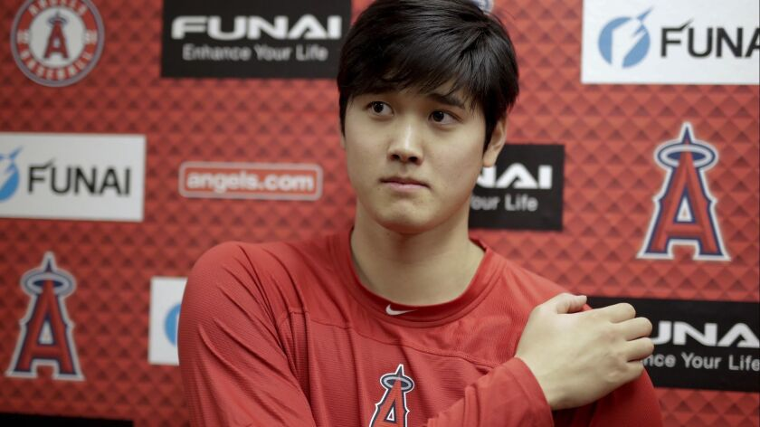 Los Angels Angels' Shohei Ohtani talks to the media at their spring baseball training facility in Te