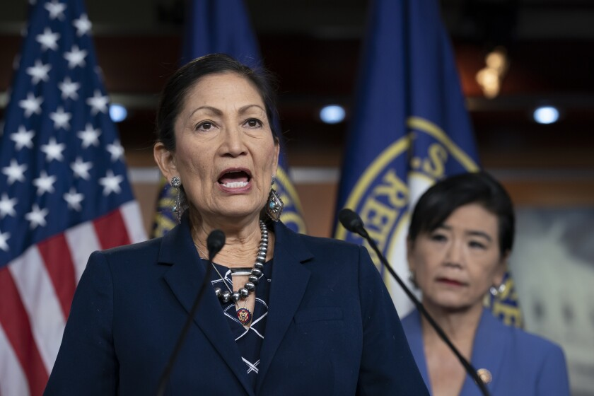FILE - In this March 5, 2020, file photo Rep. Deb Haaland, D-N.M., Native American Caucus co-chair, joined at right by Rep. Judy Chu, D-Calif., chair of the Congressional Asian Pacific American Caucus, speaks to reporters about the 2020 Census on Capitol Hill in Washington. O.J. Semans is one of dozens of tribal officials and vote activists around the country pushing selection of Haaland to become the first Native American secretary of Interior. (AP Photo/J. Scott Applewhite, File)