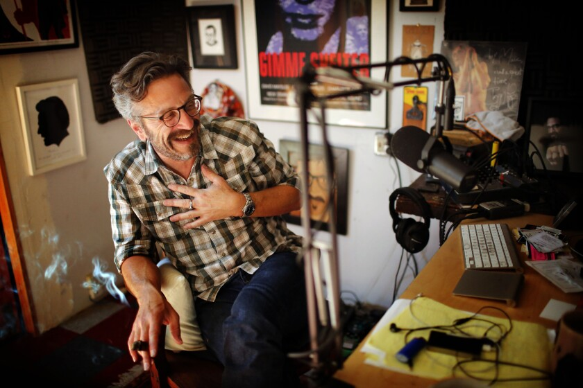 """Marc Maron enjoys a cigar in his Highland Park garage after his """"WTF"""" podcast interview with President Obama on Friday."""