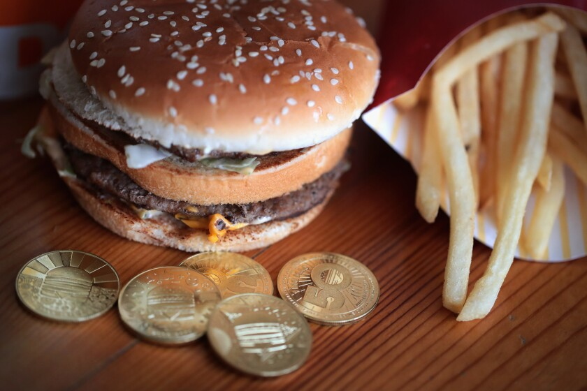 In this photo illustration, McDonald's MacCoins are shown on August 1, 2018 in Chicago, Illinois. The limited-edition coins celebrate the 50th anniversary of the introduction of the restaurant's signature Big Mac sandwich.
