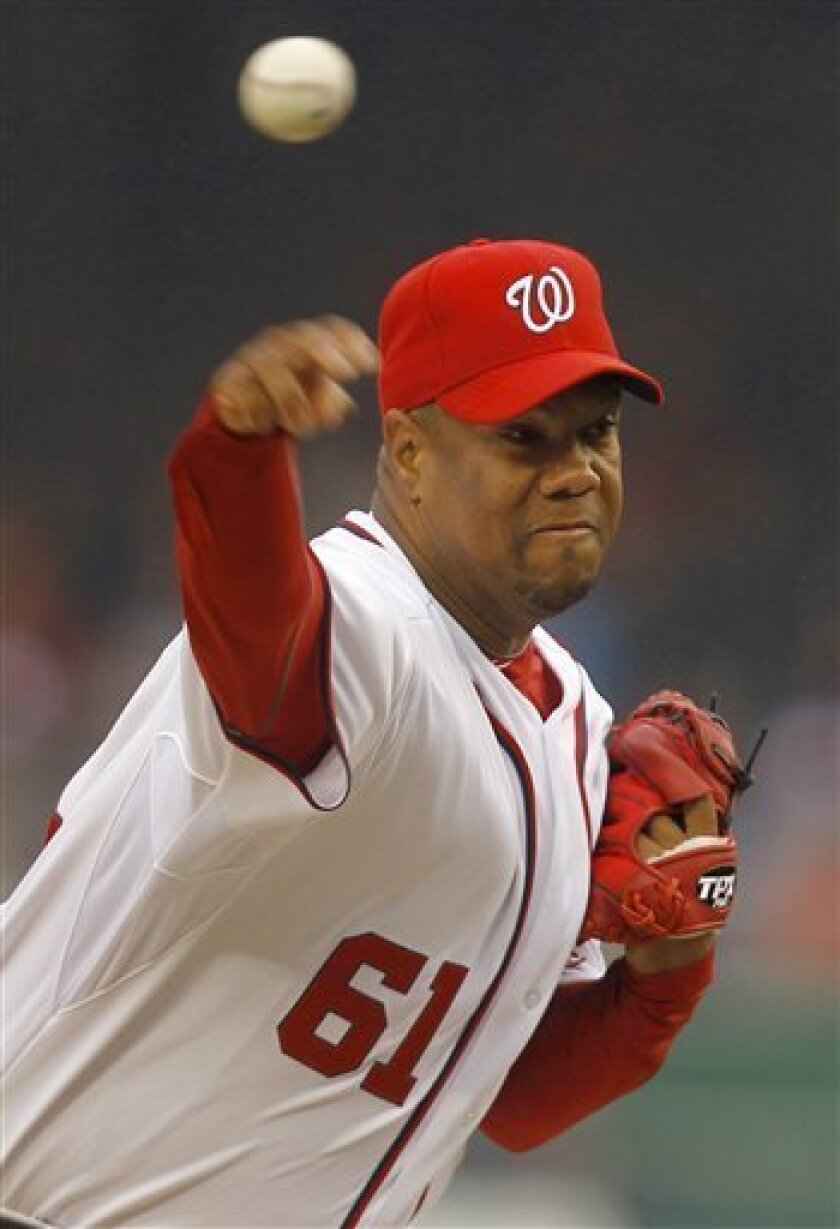 Washington Nationals pitcher Livan Hernandez throws the ball in the first inning of their opening day baseball game with the Atlanta Braves on Thursday, March 31, 2011 in Washington.(AP Photo/Alex Brandon)