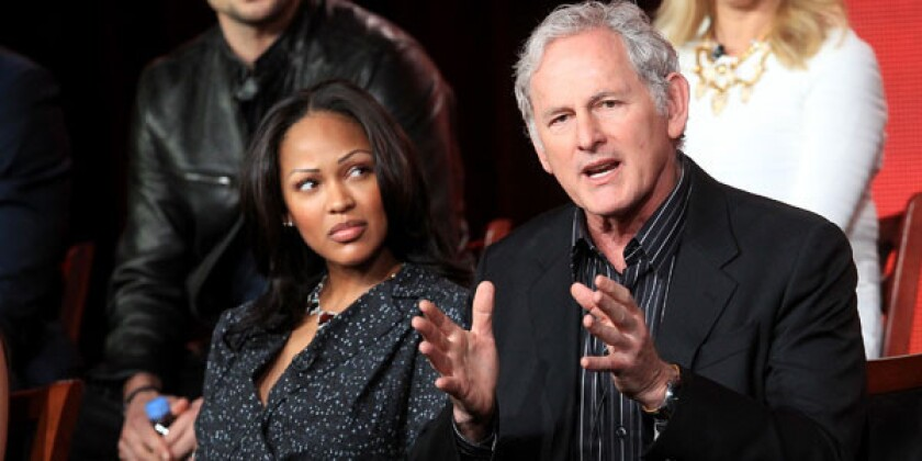 """Actors Meagan Good (L) and Victor Garber speak onstage at the """"Deception"""" panel session."""