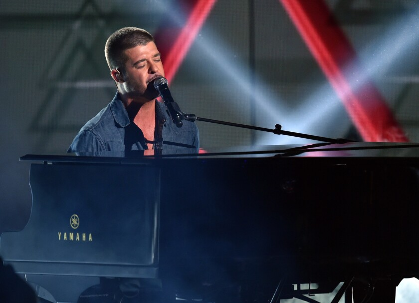 Robin Thicke performs at the BET Awards on Sunday at L.A. Live in downtown Los Angeles.