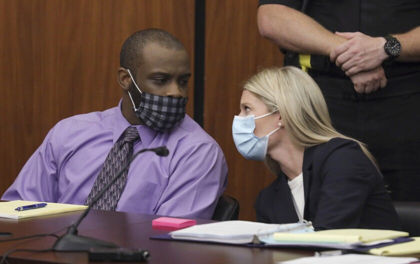 Defendant Nathaniel Rowland speaks with his attorney, Alicia Goode, right, during his trial in Richland County Court, Tuesday, July 20, 2021, in Columbia, S.C. Rowland is on trial for the kidnapping and murder of 21-year-old Samantha Josephson. (Tracy Glantz/The State via AP)