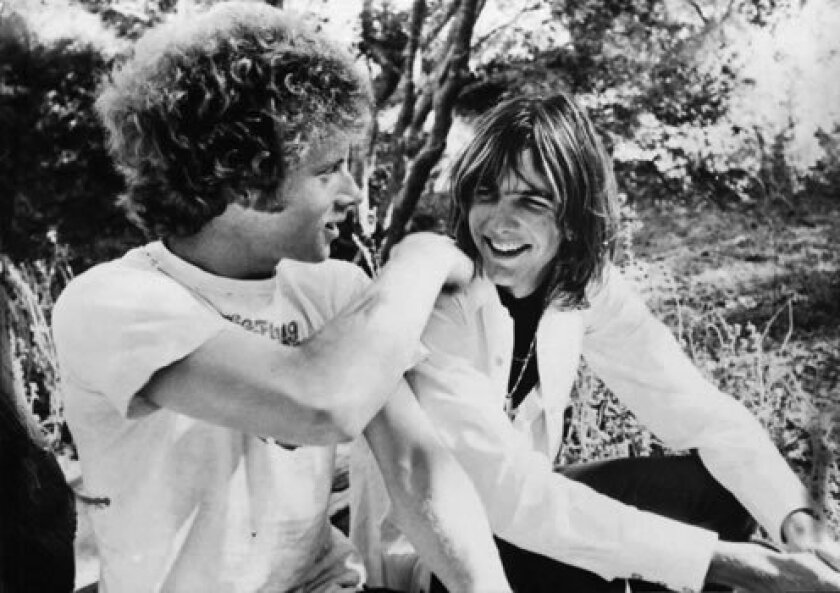 "Chris Hillman, left, who got his start playing in San Diego bluegrass bands as a teenager, is shown in 1969 with his former Byrds' band mate, Gram Parsons. The two co-founded the pioneering Los Angeles country-rock band, The Flying Burrito Brothers, which performed at the infamous Altamont festival in 1969. Hillman is featured in the new EPIX docu-series ""Laurel Canyon,"" which debuts tonight."