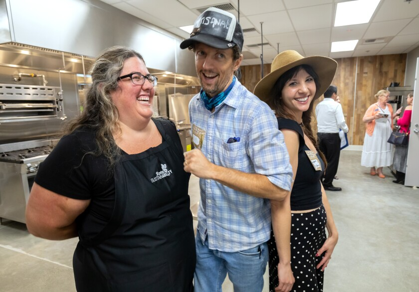 Singer/songwriter Jason Mraz and his wife, Christina Carano, right, share a laugh with Vallie Gilley, who was one of the driving forces to get the City of Oceanside's Green Oceanside Kitchen at the El Corazon Senior Center established