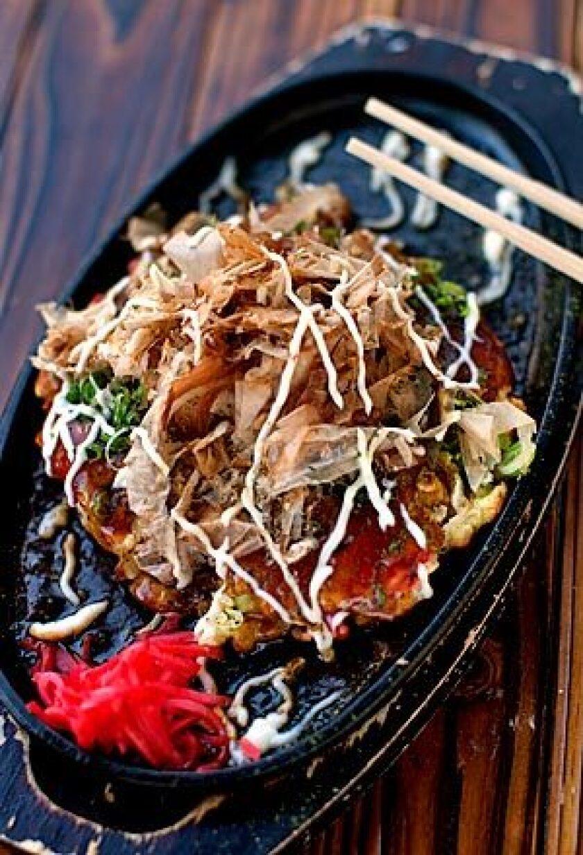 Okonomiyaki with shrimp, squid at Aburiya Toranoko.