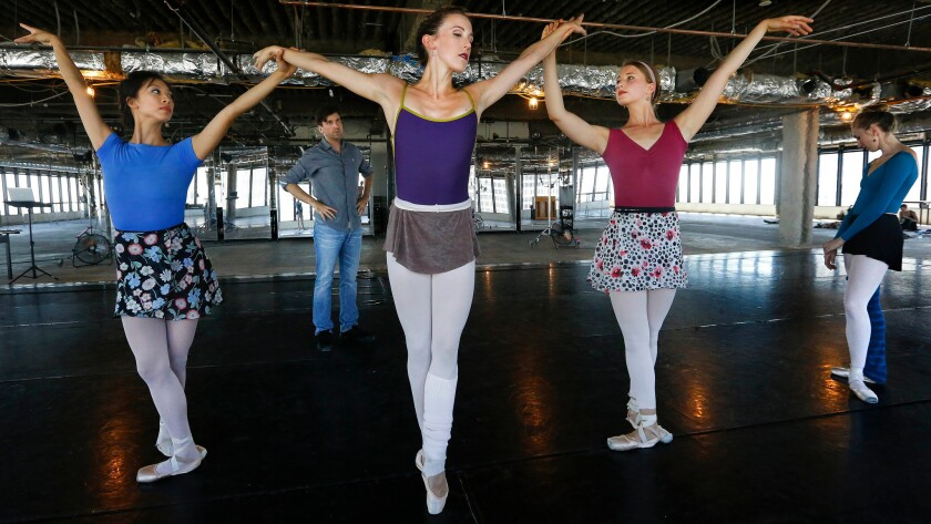 American Contemporary Ballet dancer Emily Parker, flanked by Rochelle Chang, left, and Raffaella Stroik, rehearses under the eye of choreographer Lincoln Jones.