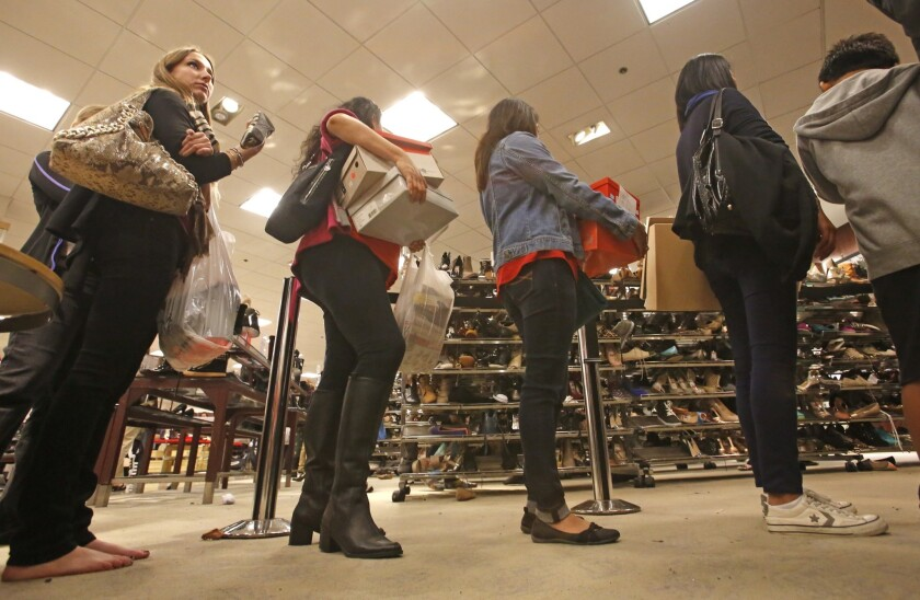 Shoppers line up to buy discounted shoes at Macy's at the South Coast Plaza mall the morning of Black Friday.