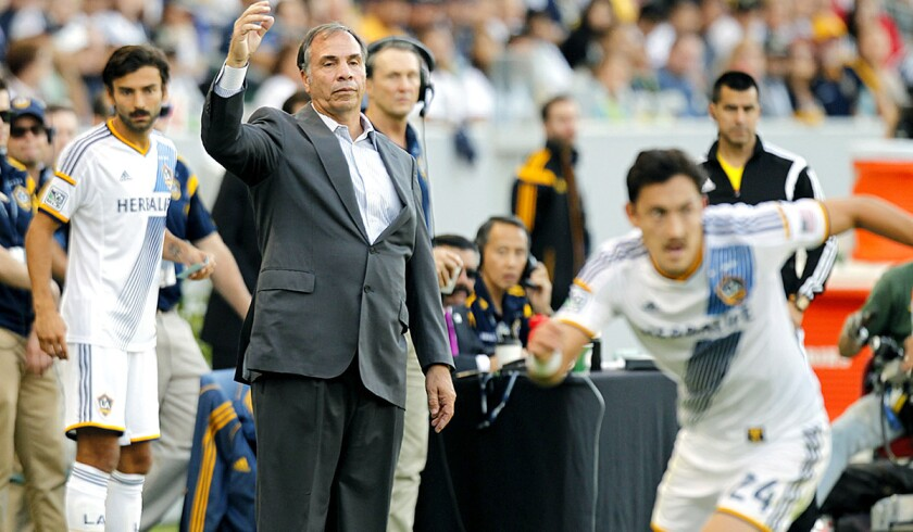 Coach Bruce Arena watches the Galaxy play the Seattle Sounders in the first leg of a two-game series for the Western Conference title. L.A. won the game, 1-0.