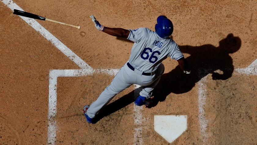 Dodgers right fielder Yasiel Puig hits a solo home run during a win over the Arizona Diamondbacks in Phoenix on April 12.