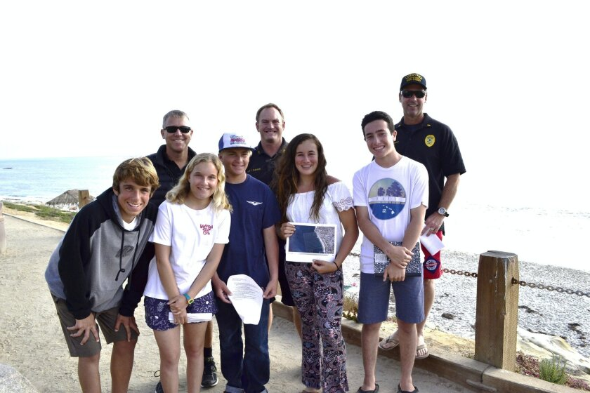 (Back) San Diego Lifeguards sergeant Marcus Schreiber, sergeant Travis Gleason and lieutenant Rich Stropky. (Front) Lorenzo Villela, Madeline Perreault, Matthew Perreault, Katy Koenig and Jordan Schultz. Not pictured: Emma Lhuillier. Courtesy