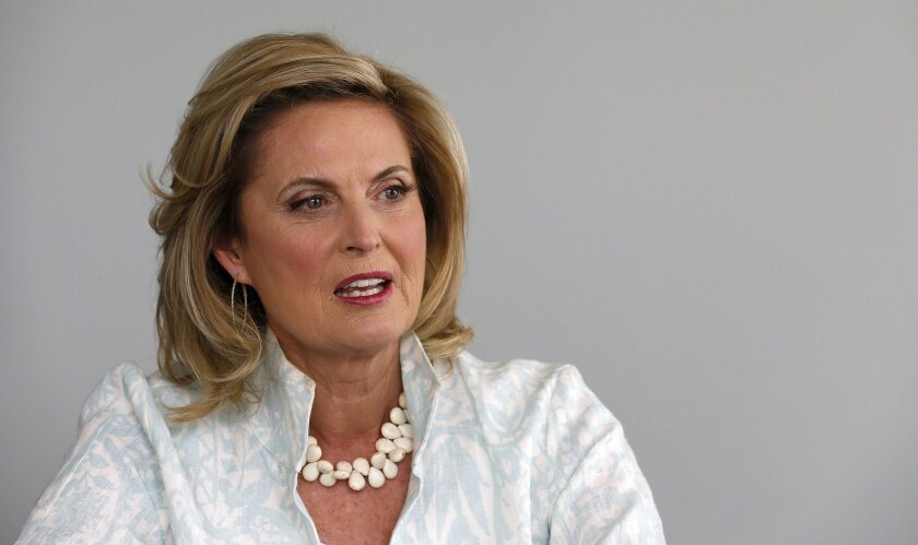 """In this Monday, Oct. 7, 2013 photo, Ann Romney, talks about her bestselling cookbook, """"The Romney Family Table: Sharing Home-Cooked Recipes & Favorite Traditions"""" in Phoenix. (AP Photo/Ross D. Franklin)"""