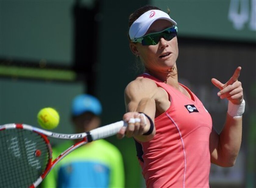 Samantha Stosur, of Australia, returns a shot against Peng Shuai, of China, during their match at the BNP Paribas Open tennis tournament, Monday, March 11, 2013, in Indian Wells, Calif. (AP Photo/Mark J. Terrill)