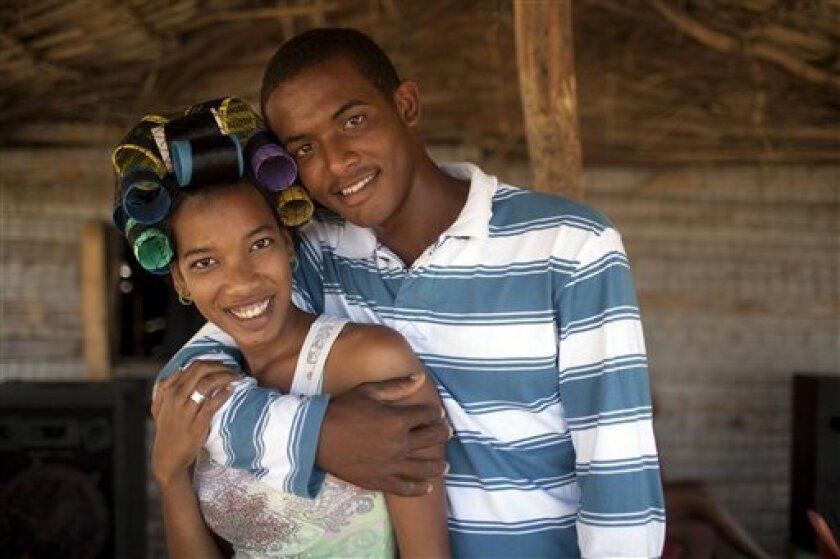 Twicy and Carlos pose for a picture in Jimani, Dominican Republic, Saturday, Jan. 29, 2011. (AP Photo/Rodrigo Abd)