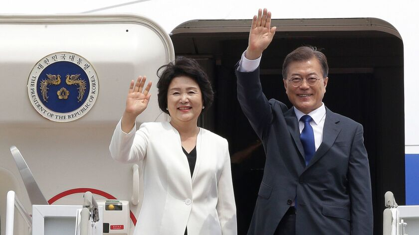 South Korean President Moon Jae-in and his wife Kim Jung-sook wave before leaving for the United States at the Seoul military airport in Seongnam, South Korea, Wednesday, June 28, 2017.