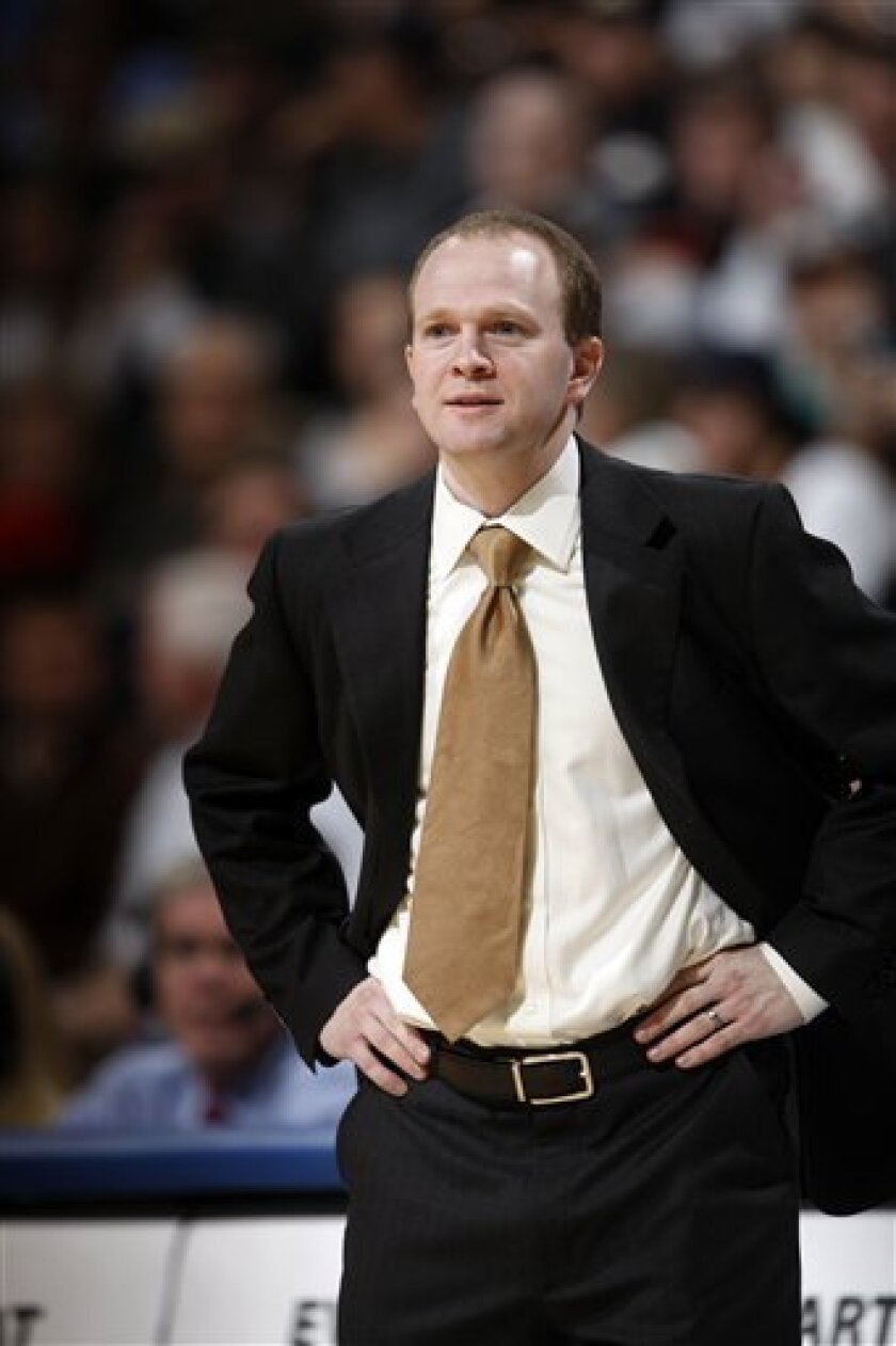 In this Tuesday, Nov. 24, 2009, photo, New Jersey Nets coach Lawrence Frank looks on against the Denver Nuggets in the first quarter of an NBA basketball game in Denver. The Nets fired Frank on Sunday, Nov. 30, after losing their first 16 games during one of the worst starts in NBA history. (AP Pho