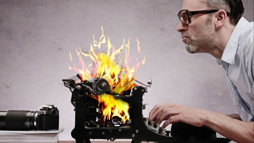 Editor with an old typewriter working on a hot story