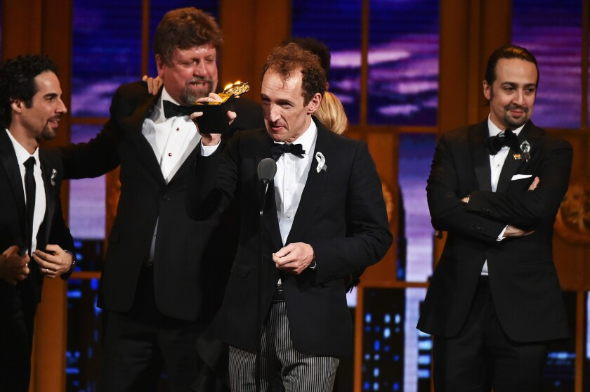 """Producer Jeffrey Seller (center) accepts the Tony Award for best musical in 2016 for """"Hamilton."""""""