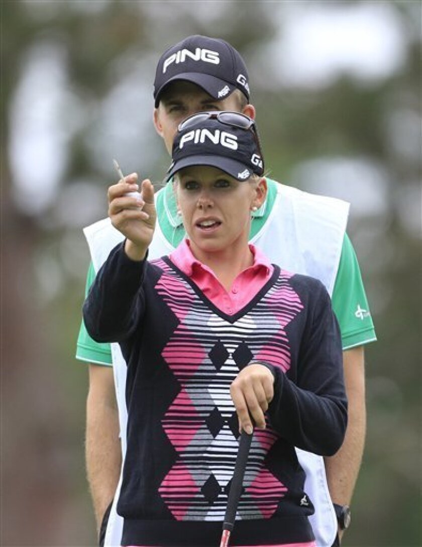 Pernilla Lindberg of Sweden eyes her drive on the 15th tee during the second round of the Jamie Farr Toledo Classic at the Highland Meadows Golf Club in Sylvania, Ohio, Friday, Aug. 10, 2012. (AP Photo/Carlos Osorio)