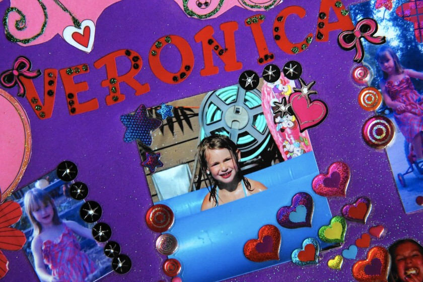 A collage commemorates 6-year-old Veronica Moser-Sullivan, killed in the July 2012 movie theater massacre in Aurora, Colo. Veronica's mother testified as the prosecution rested its case in James Holmes' trial.