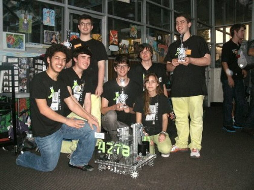 De-Evolution team members with their robot and trophies awarded for winning  their second tournament this season: Yousuf Soliman, Ryan Lee, Colin Murphy,  Nic Stone, Noah Sutton-Smolin, Merry Hodgman, Tristan Murphy.