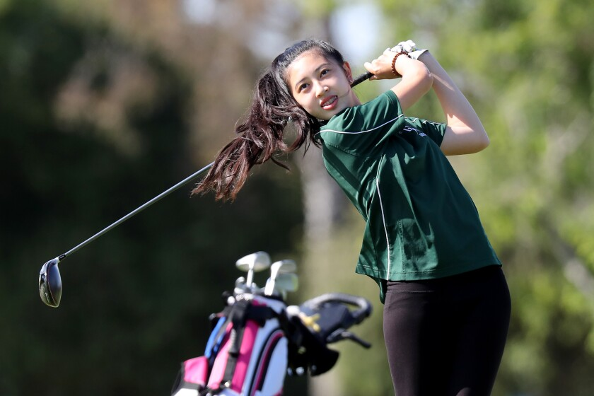 Costa Mesa's Sydney Ngo, shown teeing off in a May match, was the medalist for the Mustangs girls' golf team on Tuesday.