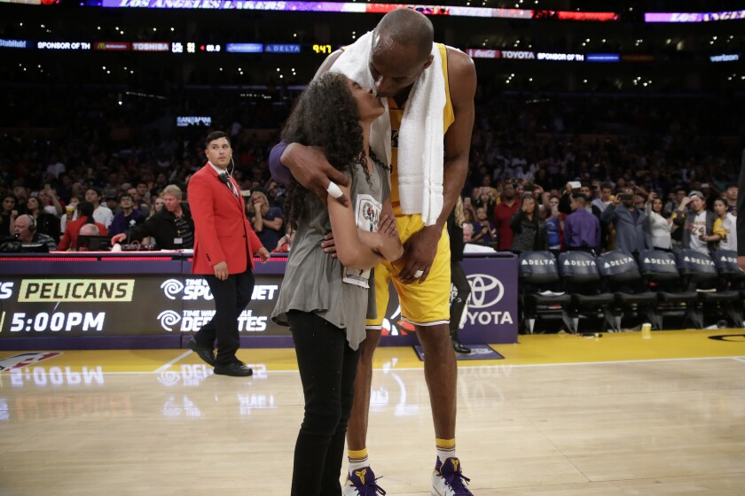 Kobe Bryant kisses his daughter Gianna at center court following a game against the Clippers at the Staples Center in 2016.