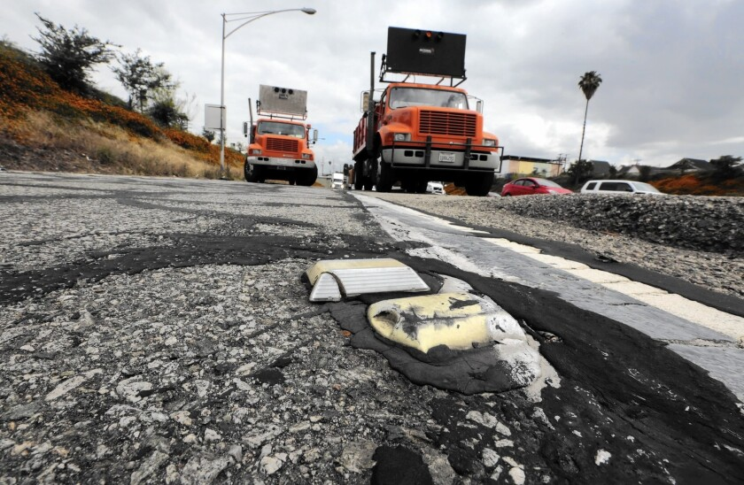 Officials estimate it will cost $59 billion to fix the state's now-crumbling roads and freeways. Above, the Main Street offramp from the southbound 5 Freeway is repaired this month in downtown Los Angeles .