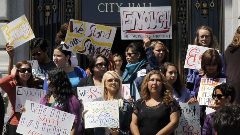 This 2012 photo shows a coalition against domestic violence gathered on the steps of City Hall in San Francisco.