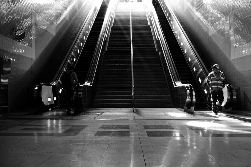 A man enters the light-filled downtown Los Angeles Metro station.