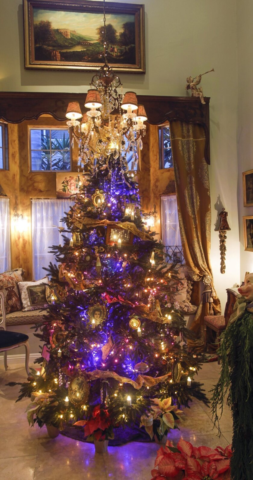 Jennifer Chapman's Christmas tree is decorated with antique bird figurines and ornaments with flocking once belonging to her late mother and grandmother. There also are newer decorations made by her children when they were young.