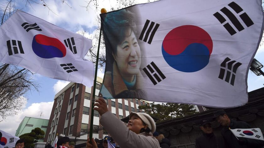 A supporter of South Korean President Park Geun-Hye rallies in Seoul in opposition to her impeachment on Thursday.