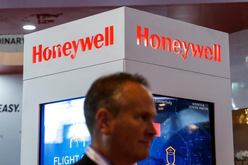 A man walks past the logo of Honeywell. EFE/EPA/FILE