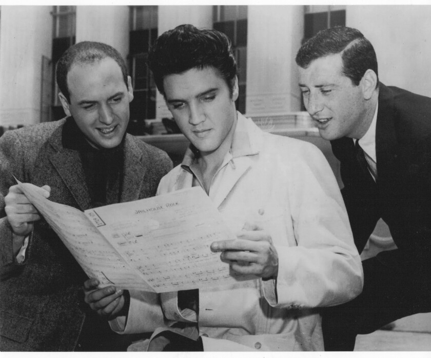 Mike Stoller, left, with Elvis and Jerry Leiber in 1957.