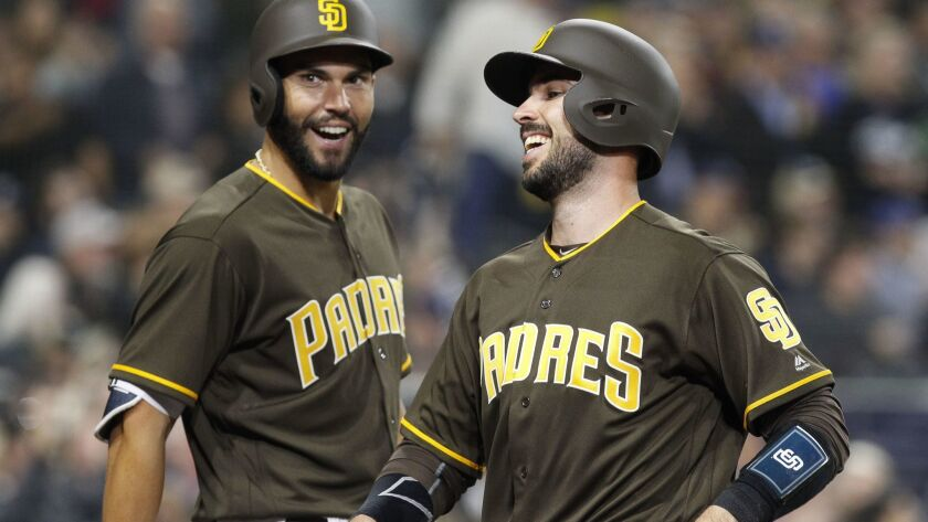 SAN DIEGO, March 30, 2018 | The Padres' Austin Hedges, right, and Eric Hosmer smile after Hedges sc